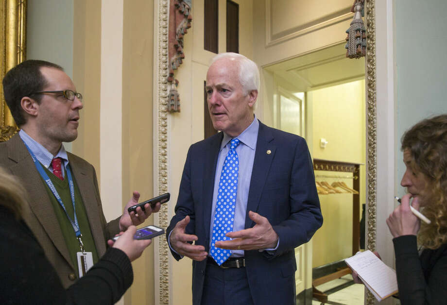 Senate Majority Whip John Cornyn of Texas, talks to reporters on Capitol Hill in Washington, Wednesday, Feb. 3, 2016, as he walks to a closed-door meeting with fellow Republicans during work on the energy reform bill. Democrats want to attach a federal aid package to the bipartisan energy bill to help the Flint, Mich., health crises caused by corroded lead pipes. (AP Photo/J. Scott Applewhite)