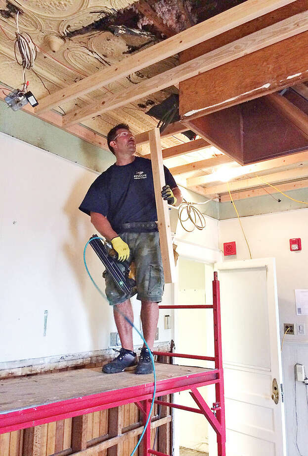 contributed photo The oldest fire station in the city is station 3, formed as the Mayflower Hook and Ladder in the 1890's, is undergoing extensive restorative effort led by the firefighters who work there including firefighter Ron Kayal.