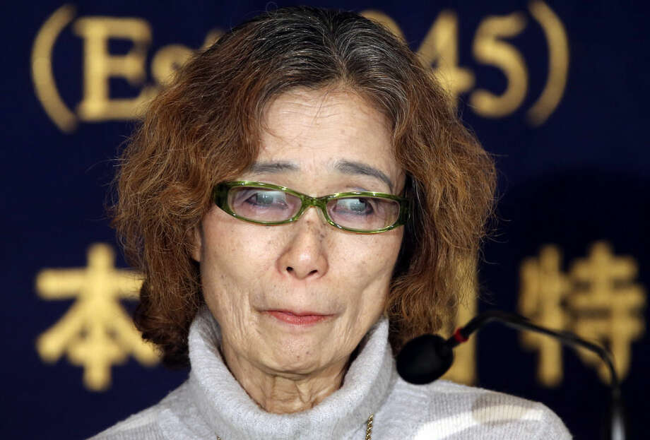 Junko Ishido, mother of Japanese journalist Keni Goto taken hostage by Islamic State, speaks during a press conference in Tokyo, Friday, Jan. 23, 2015. Goto's mother said her son went to Syria to try to secure a friend's release, corroborating comments by others who said he was trying to rescue Yukawa, who was taken hostage earlier. The deadline for paying ransom for two Japanese hostages held by the Islamic State group was fast approaching early Friday with no signs of a breakthrough. (AP Photo/Koji Sasahara)