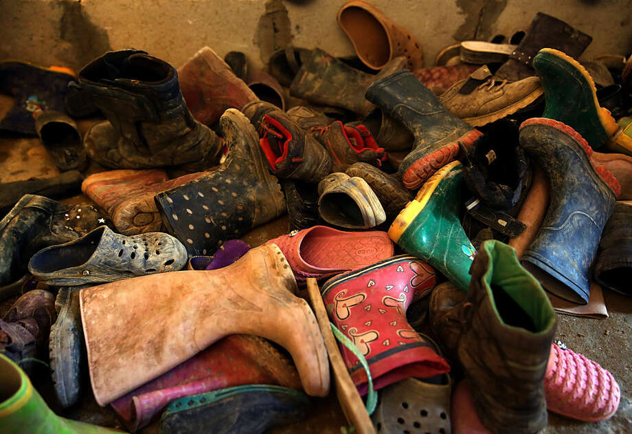 In this Wednesday, Jan. 27, 2016, shoes of Syrian refugee children lay on the ground at the entrance to a makeshift school in a tent, at a Syrian refugee camp in the village of Qab Elias, Bekaa Valley, Lebanon. With Lebanese schools forced to turn down Syrian children for lack of space, some refugees have resorted to a bootstrap solution: Syrian teachers who are refugees themselves, volunteer their time to educate the next generation out of tents. (AP Photo/Bilal Hussein)