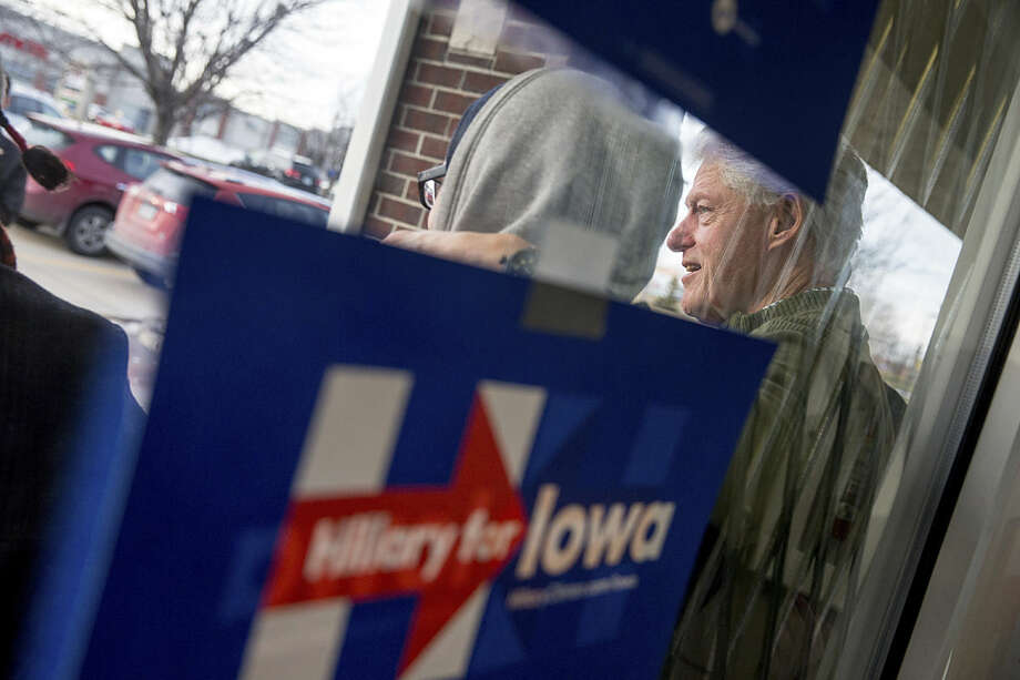 Former President Bill Clinton poses for a photograph outside a campaign office for Democratic presidential candidate Hillary Clinton in Ankeny, Iowa, Monday, Feb. 1, 2016. (AP Photo/Andrew Harnik)