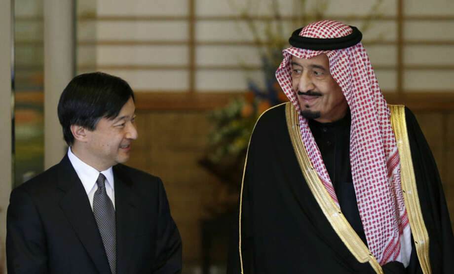 FILE - In this file photo taken on Feb. 24, 2014, Saudi Arabia's Crown Prince Salman bin Abdul Aziz al-Saud, right, is welcomed by Japan's Crown Prince Naruhito, left, at the Togu Palace in Tokyo. Saudi Arabia's newly enthroned King Salman moved quickly Friday, Jan. 23, 2015, to name a future successor to the crown in his oil-rich kingdom, a significant appointment that puts the kingdom's future squarely in the hands of a new generation. (AP Photo/Toru Hanai, Pool, File)