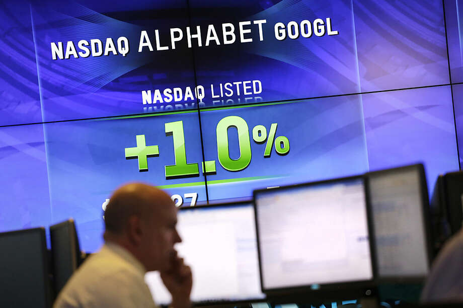 Electronic screens post the price of Alphabet stock, Monday, Feb. 1, 2016, at the Nasdaq MarketSite in New York. Alphabet, the parent company of Google, reports quarterly earnings Monday. (AP Photo/Mark Lennihan)