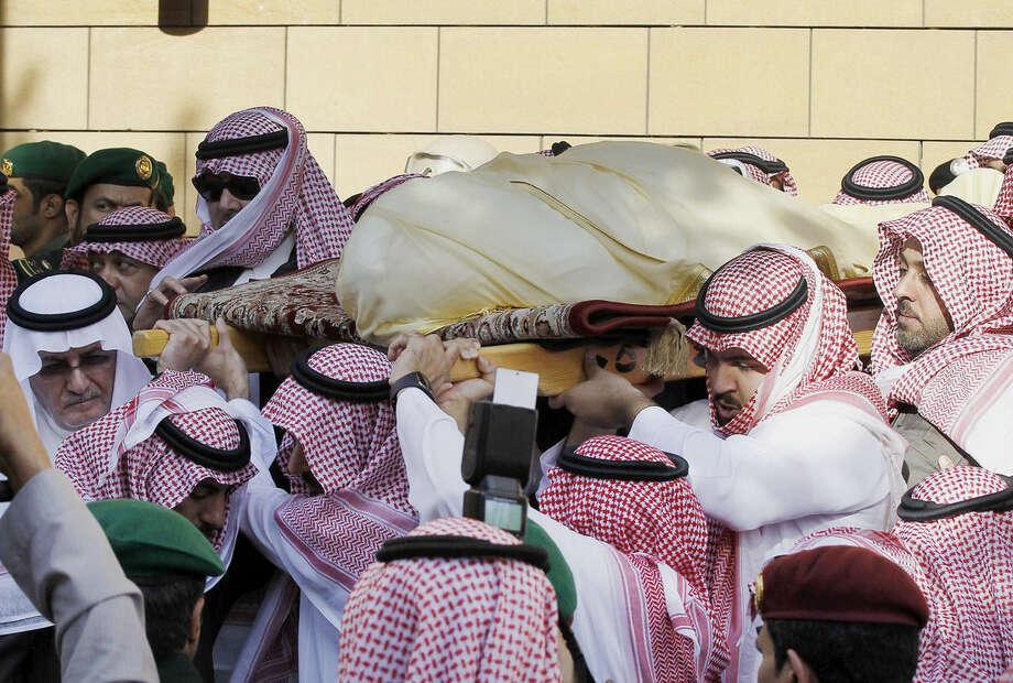 Mourners carry the body of King Abdullah of Saudi Arabia outside the Imam Turki bin Abdullah mosque in Riyadh, Saudi Arabia, Friday, Jan. 23, 2015. On early Friday, Saudi state TV reported King Abdullah died at the age of 90. (AP Photo)
