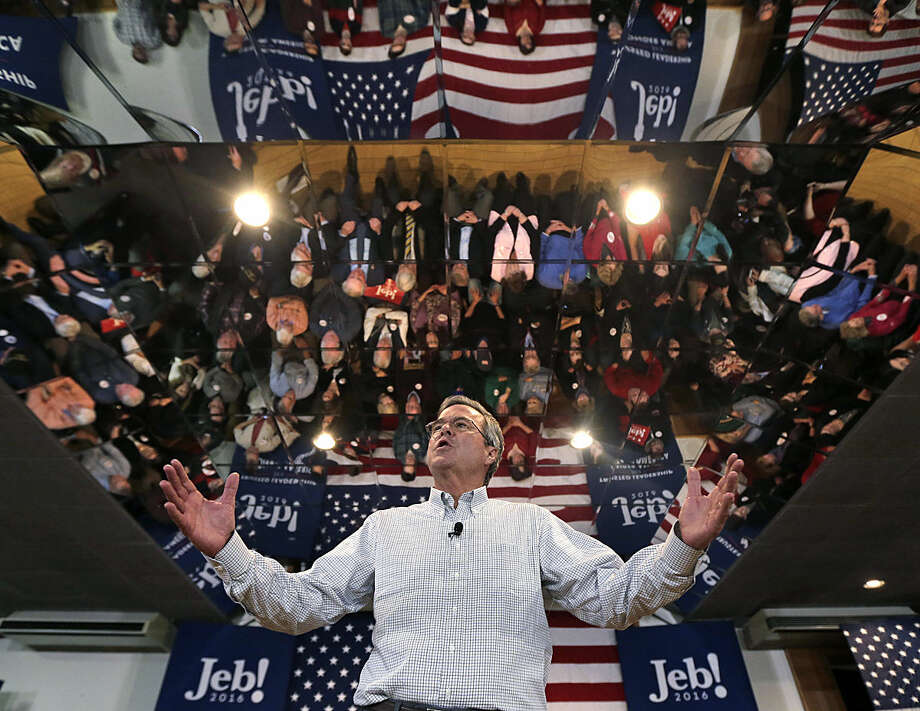 Republican presidential candidate, former Florida Gov. Jeb Bush gestures as he addresses a gathering during a campaign stop in Manchester, N.H., Monday, Feb. 1, 2016. (AP Photo/Charles Krupa)