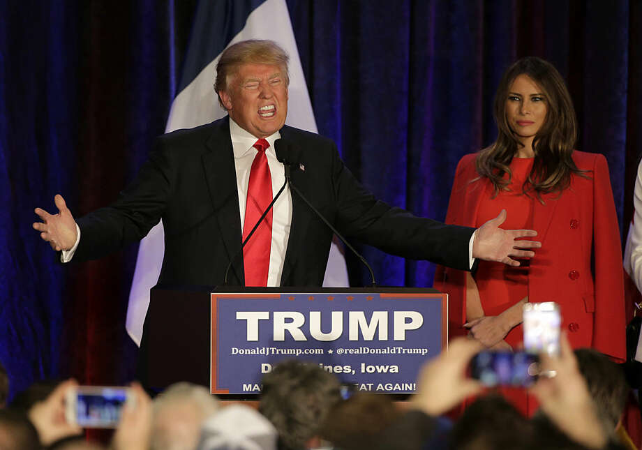 Republican presidential candidate, businessman Donald Trump speaks as his wife Melania watches at his caucus night rally, Monday, Feb. 1, 2016, in West Des Moines, Iowa. (AP Photo/Jae C. Hong)