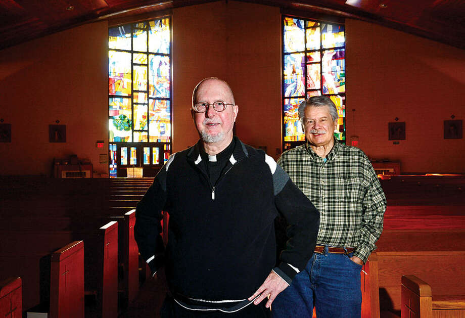 Hour photo / Erik Trautmann Father David Blanchfield, pastor of St. Jeromes Church with the help of Dan Loch, Head of the Pastoral Council, has led the church's mission to offer individual works of charity and most recently advocated for the national issue of gun safety.