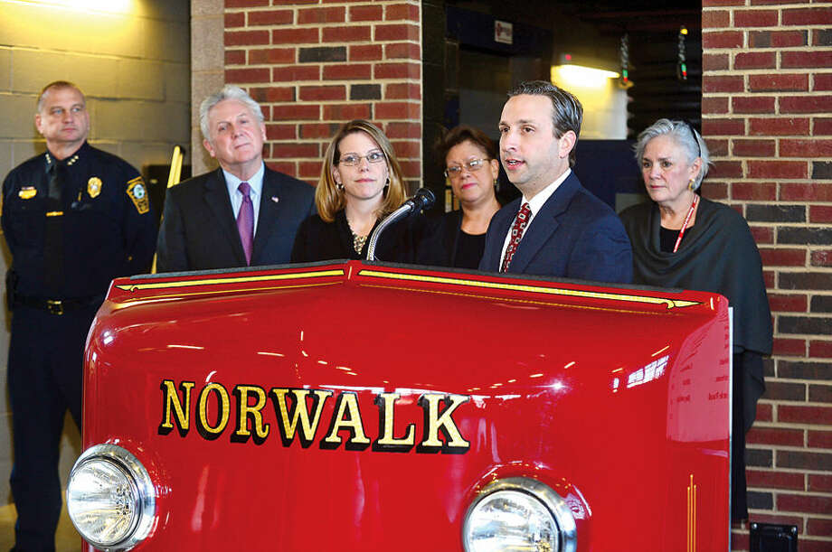 State Senate Majority Leader Bob Duff joins local business representatives and Norwalk Mayor Harry Rilling, to present checks to Norwalk nonprofits as part of a Duff's holiday giving campaign Friday morning at the Norwalk Fire Department Headquarters.Senator Duff helped coordinate the donation of $16,500 by businesses including Altria, Aetna, Cablevision, Dominion, The Travelers, and others, to representatives including; Executive Director Stephen Bentkover for Norwalk Reads!, Norwalk Police Chief Thomas Kuhalwik for Norwalk PAL, Norwalk Fire Chief Denis McCarthy for the Fire Victims Fund, Executive Director Kari Pesavento for the Children's Connection, Executive Administrator Elsie Lopez for the Carver Foundation, Executive Director Cici Maher for Person-to-Person, and Executive Director Kevin Mullins for Community Plates during the brief ceremony.