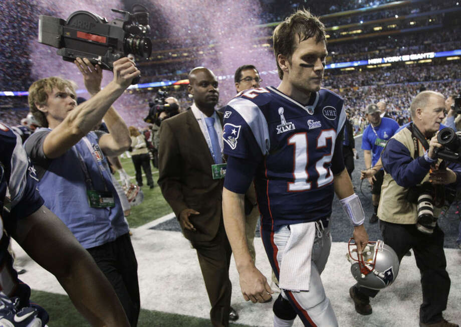 FILE - In this Feb. 5, 2012, file photo, New England Patriots quarterback Tom Brady walks off the field after the Patriots' 21-17 loss to the New York Giants in NFL football's Super Bowl XLVI in Indianapolis. The Patriots own a share of the short-term success mark in Super Bowls: three in a four-year span. They've been back twice since their last championship victory and failed to add to their collection. (AP Photo/Paul Sancya, File)