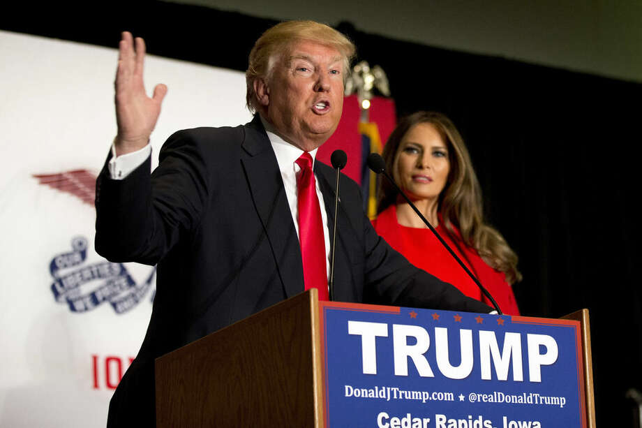 Republican presidential candidate Donald Trump is joined by his wife Melania Trump as speaks during a campaign event, Monday, Feb. 1, 2016, in Cedar Rapids, Iowa. (AP Photo/Mary Altaffer)