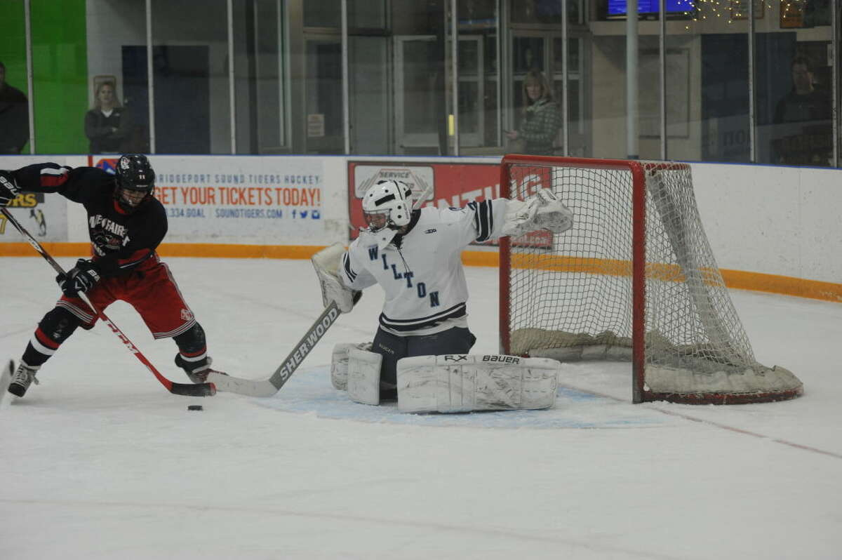 Wilton boys hockey game against Trinity Catholic is one of the games that have been postponed due to the possible snowstorm on Saturday. (Hour photo/John Nash)