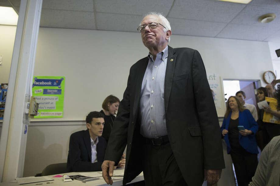Democratic presidential candidate, Sen. Bernie Sanders, I-Vt. visits his campaign headquarters to thank volunteers, Monday, Feb. 1, 2016, in Des Moines, Iowa. (AP Photo/Evan Vucci)
