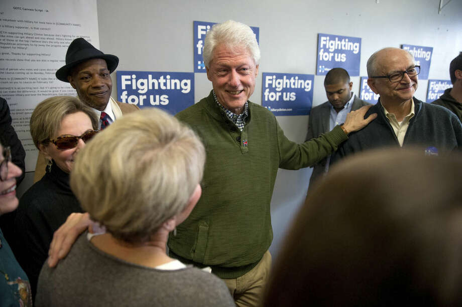 Former President Bill Clinton greets supporters at a campaign office for Democratic presidential candidate Hillary Clinton in Ankeny, Iowa, Monday, Feb. 1, 2016. (AP Photo/Andrew Harnik)