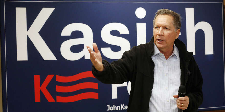 Republican presidential candidate, Ohio Gov. John Kasich speaks during a town hall campaign stop before next weeks earliest in the nation presidential primary, Monday, Feb. 1, 2016, in Rochester, N.H. (AP Photo/Jim Cole)