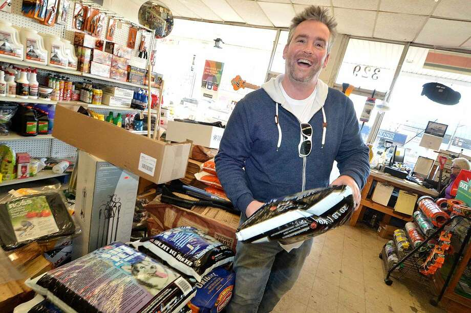Hour Photo/Alex von Kleydorff Westport's Eric Stanger picks up some supplies like Pet safe Ice melt and a case of Pine Mountain Fireplace logs at Carlyn Hardware on Westport Ave friday. Preparing for a wintry coastal storm on Saturday Eric says the next item to buy is beer .