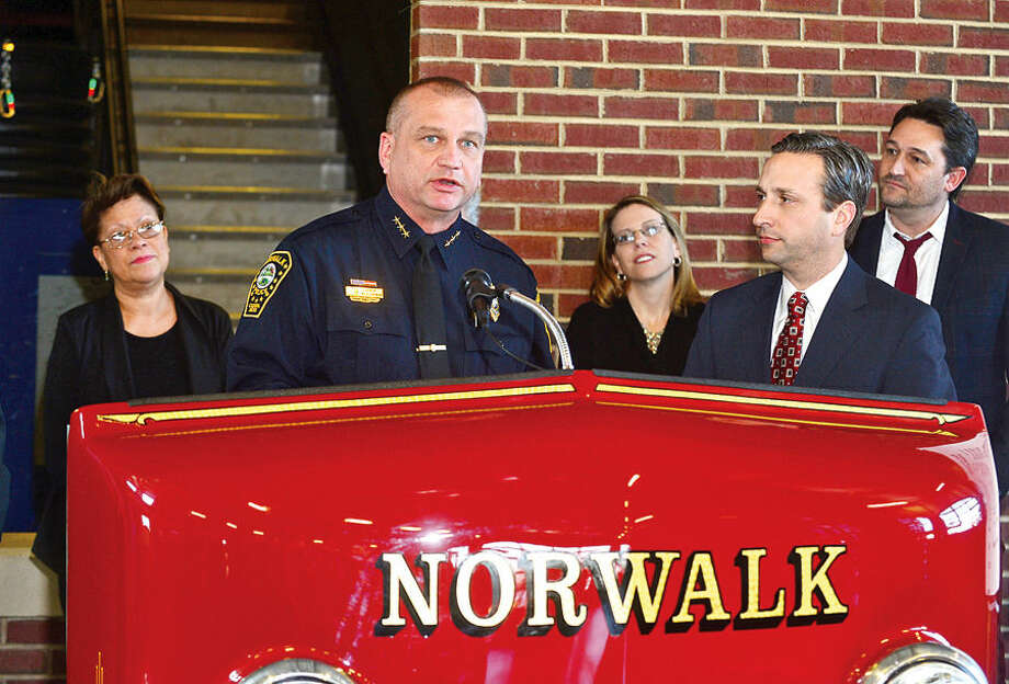 Hour photo / Erik Trautmann Norwalk Police Chief Thomas Kulhawik thanks State Senate Majority Leader Bob Duff for a check to Norwalk PAL as part of a Duff's holiday giving campaign Friday morning at the Norwalk Fire Department Headquarters. Senator Duff helped coordinate the donation of $16,500 by businesses including Altria, Aetna, Cablevision, Dominion, The Travelers, and others, to Norwalk Reads!, Norwalk PAL, The Children's Connection,The Carver Foundation, Person-to-Person, St. Vincent De Paul, and Community Plates during the brief ceremony.