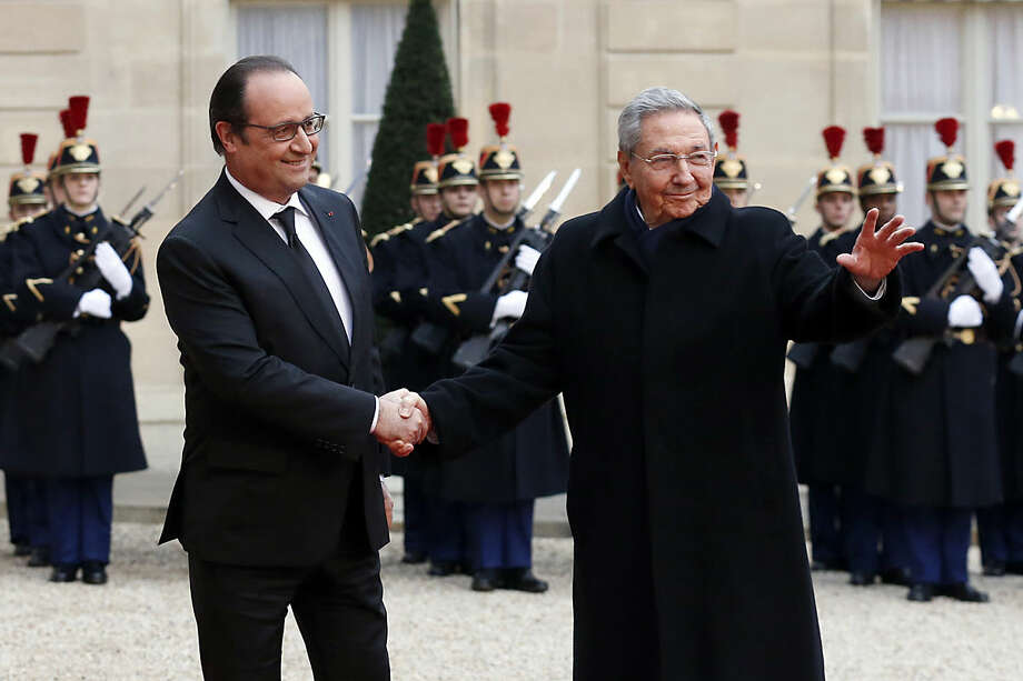 French president Francois Hollande, left, welcomes Cuban President Raul Castro upon his arrival for a meeting at the Elysee Palace, in Paris, France, Monday, Feb. 1, 2016. Cuban President Raul Castro is paying a state visit to France, in the first European foray by a Cuban leader in two decades, as Cuba opens up its economy. (AP Photo/Francois Mori)