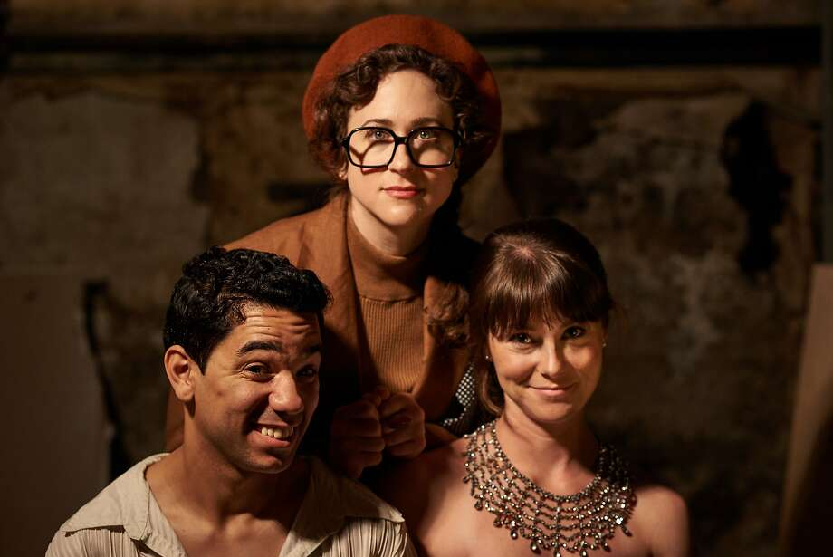 Perennial up-and-coming director Barri Cantaloupe (Becky Hirschfeld) is flanked by romantic leads Prince (Edwin Ortiz, left) and Odette (KC Gleason). Photo: Nelson Murray, Mission CTRL