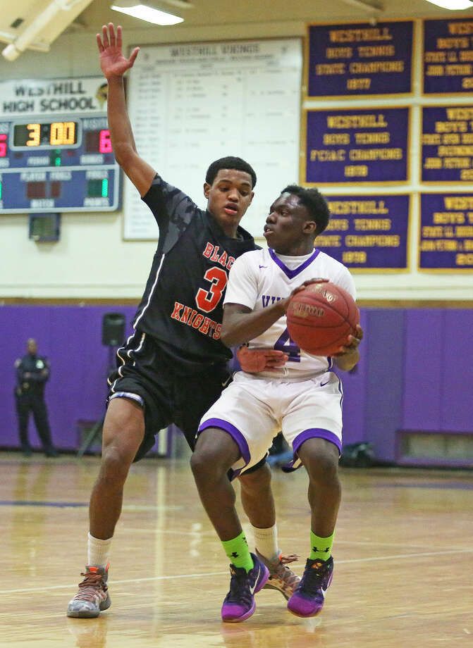 Westhill's #4, Tarik Rivers, trys to make a pass while and Stamford's #3, Yan Carlos Marte, plays defense during a game at Westhill Monday evening. Hour Photo / Danielle Calloway