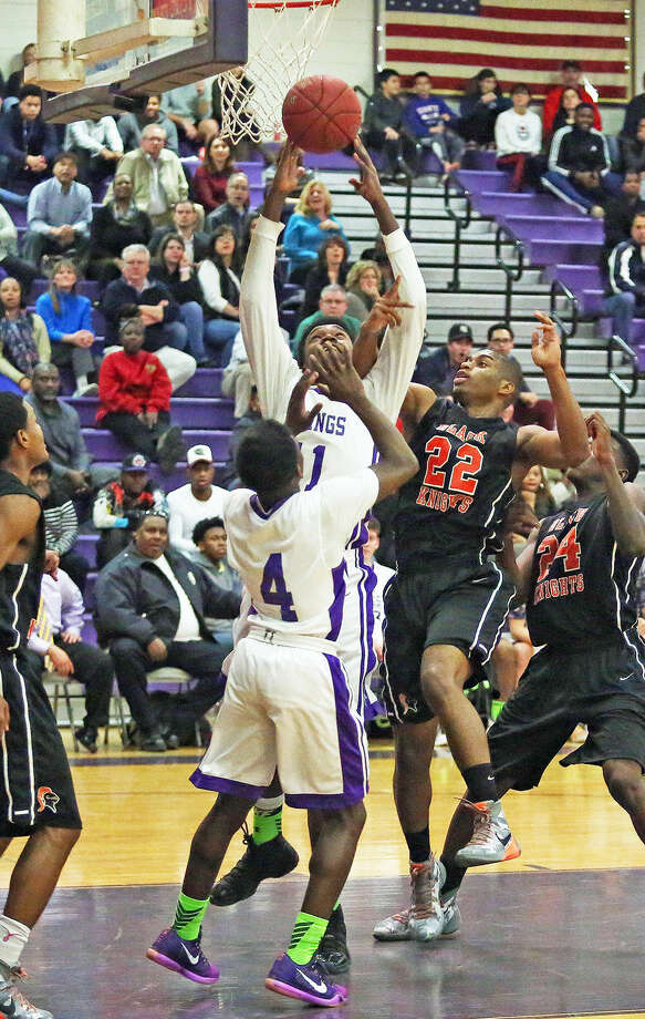 Westhill's #1, Carl Gedeon, and Stamford's #22, Steffan Harding, go for the a rebound during a game at Westhill Monday evening. Hour Photo / Danielle Calloway