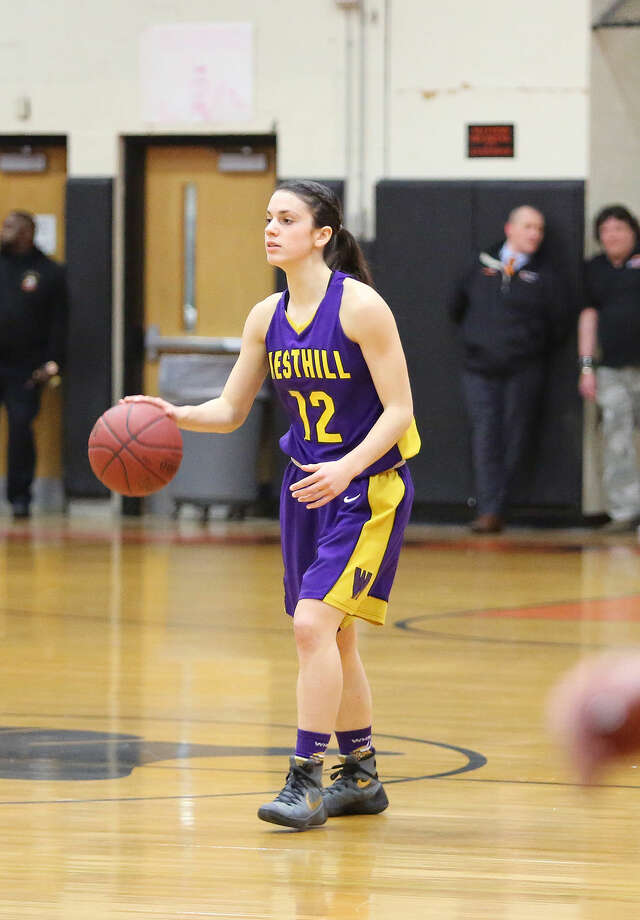 Westhill's #12, Olivia Wise, dribbles the ball during a game against Stamford at Stamford High School Monday evening. Hour Photo / Danielle Calloway
