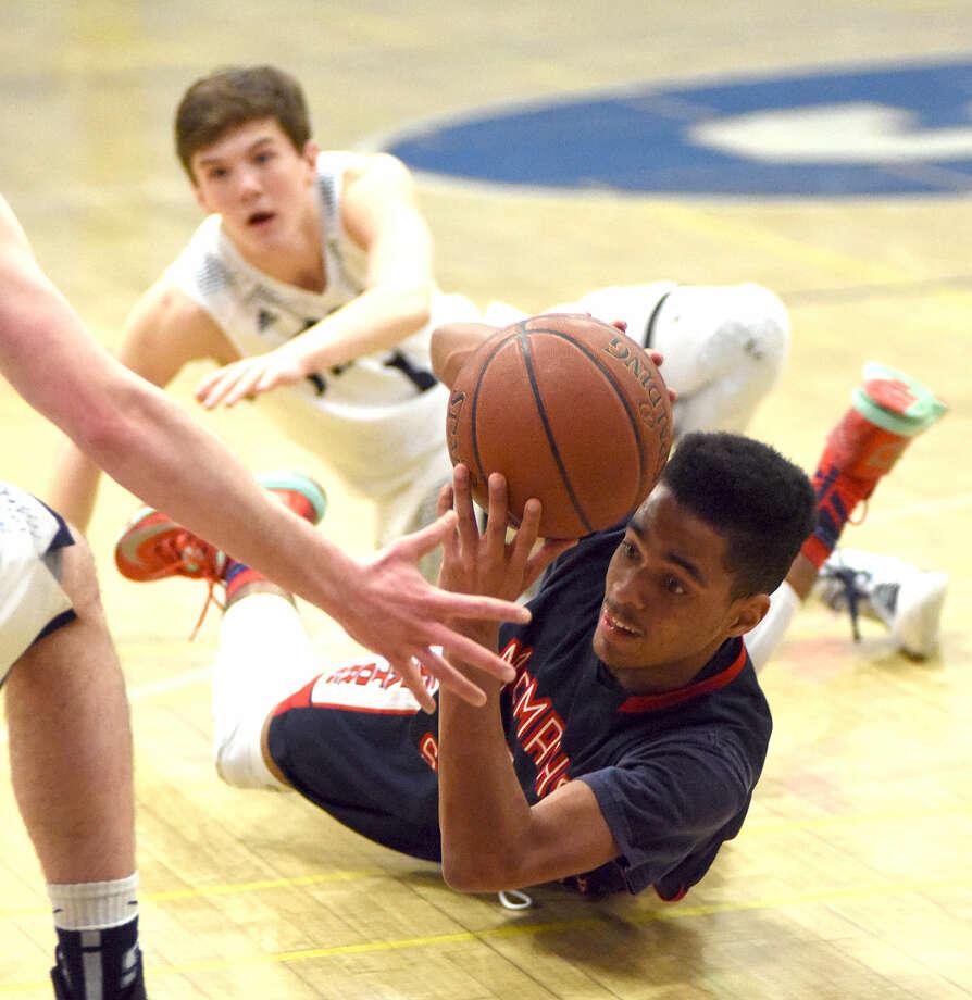Hour photo/John Nash - The Staples boys basketball team defeated Brien McMahon 65-54 on Thursday, Jan. 22, 2015.