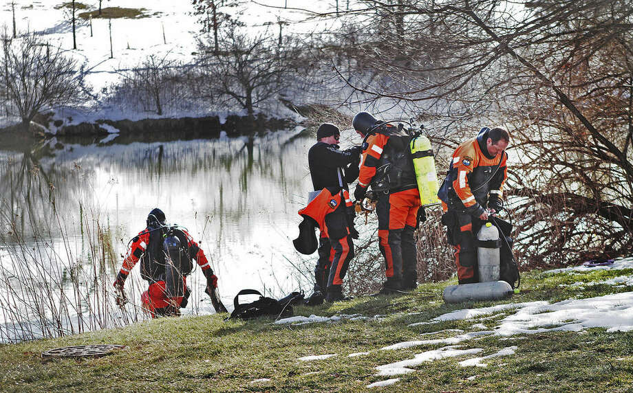 In this Jan. 31, 2016 photo, troopers prepare to search the Duck Pond in Blacksburg, Va. The investigation continued in the death of Nicole Madison Lovell as a state police search and recovery team searched the pond for evidence on the Virginia Tech Campus. (Edmee Rodriguez/The Roanoke Times via AP) LOCAL TELEVISION OUT; SALEM TIMES REGISTER OUT; FINCASTLE HERALD OUT; CHRISTIANBURG NEWS MESSENGER OUT; RADFORD NEWS JOURNAL OUT; ROANOKE STAR SENTINEL OUT; MANDATORY CREDIT