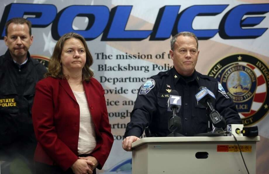 Montgomery County Commonwealth's Attorney Mary Pettitt, left, and Blacksburg Police Chief Anthony Wilson listen to questions during a news conference Saturday, Jan. 30, 2016, in Blacksburg Va. Blacksburg Police have arrested and charged a Virginia Tech Student with felony abduction in relation to the disappearance of 13-year-old Nicole Madison Lovell. (Matt Gentry/The Roanoke Times via AP) LOCAL TELEVISION OUT; SALEM TIMES REGISTER OUT; FINCASTLE HERALD OUT; CHRISTIANBURG NEWS MESSENGER OUT; RADFORD NEWS JOURNAL OUT; ROANOKE STAR SENTINEL OUT; MANDATORY CREDIT MBI