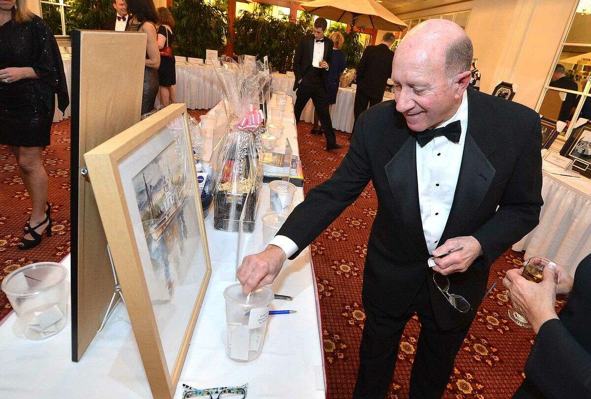 Hour Photo/Alex von Kleydorff Bob Lametta has been to every Mayors Ball and bids on a nautical print during the silent auction at The Twenty Second Annual Mayor's Ball
