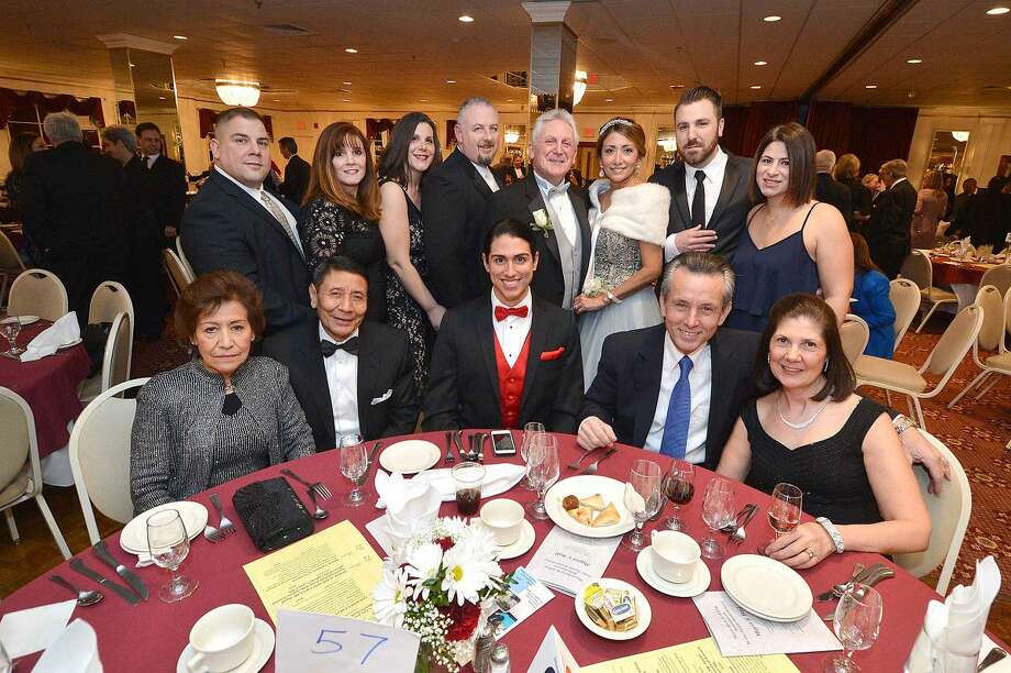 Hour Photo/Alex von Kleydorff Mayor Harry Rilling and Lucia pose for a family group photo at the Mayor's Ball