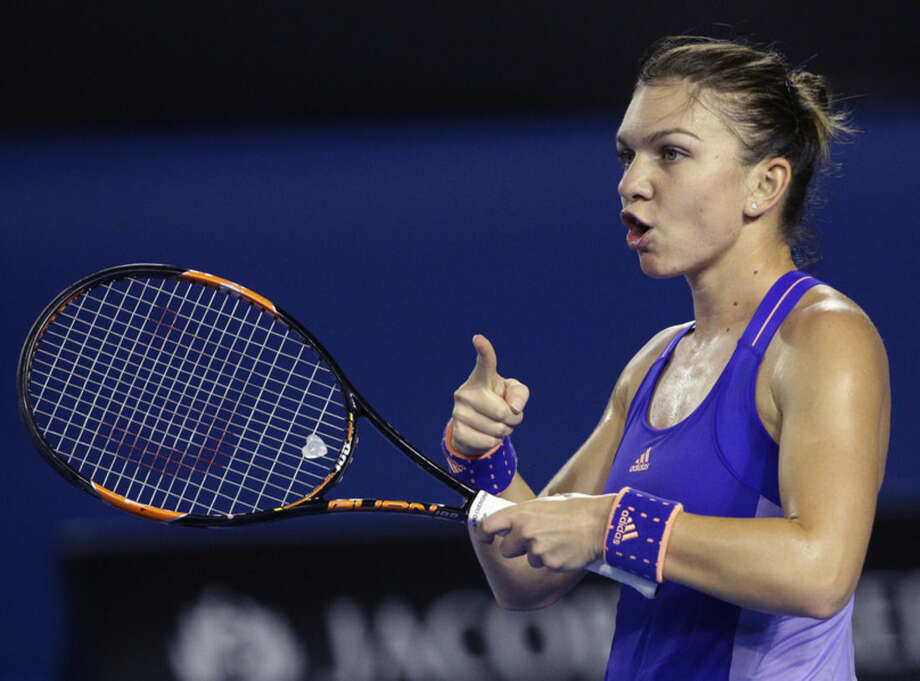 Simona Halep of Romania reacts as she plays Jarmila Gajdosova of Australia during their second round match at the Australian Open tennis championship in Melbourne, Australia, Wednesday, Jan. 21, 2015. (AP Photo/Rob Griffith)