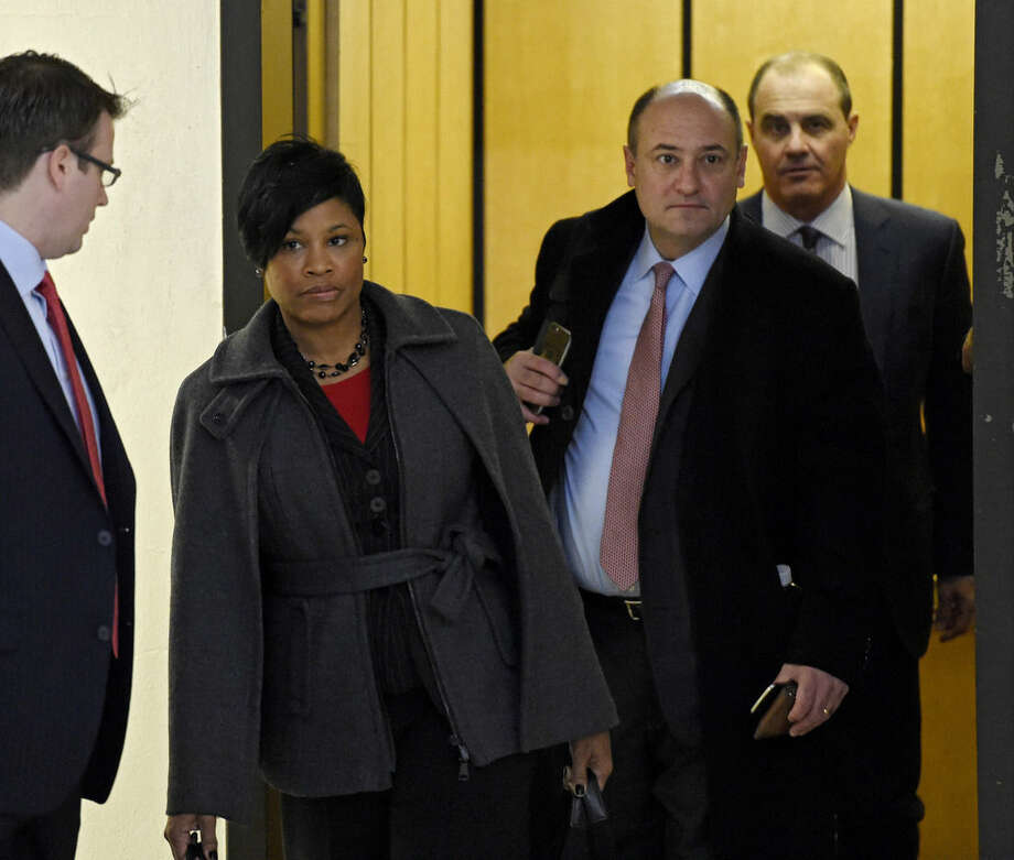 Members of Bill Cosby's law team, from left, Monique Pressley, Christopher Tayback and Brian McMonagle arrive at the Montgomery County Courthouse on Tuesday, Feb. 2, 2016 before a pre-trail hearing in Philadelphia. The defense will argue that Cosby had a deal with a suburban Philadelphia prosecutor in 2005 that he wouldn't be prosecuted and should testify freely in accuser Andrea Constand's civil lawsuit. That testimony, released only last year, prompted the successors of former Montgomery County District Attorney Bruce L. Castor Jr. to reopen the case and ultimately charge the 78-year-old Cosby with felony sexual assault. Cosby has not yet entered a plea. (Clem Murray/The Philadelphia Inquirer via AP, Pool)