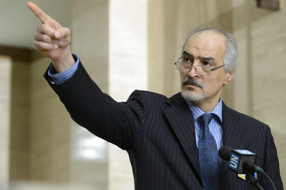 Syrian chief negotiator and the country's ambassador to the U.N. Bashar Ja'afar speaks to the media after a round of negotiations between the Syrian government and the opposition at the European headquarters of the United Nations in Geneva, Switzerland, Tuesday, Feb. 2, 2016. (Laurent Gillieron/Keystone via AP)