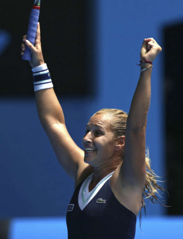 Dominika Cibulkova of Slovakia celebrates her win over Maria Sharapova of Russia during their fourth round match at the Australian Open tennis championship in Melbourne, Australia, Monday, Jan. 20, 2014.(AP Photo/Aaron Favila)