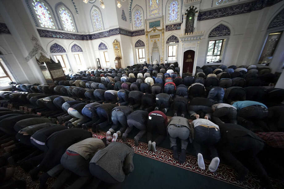 Muslims residing in Japan offer Friday prayers at Tokyo Camii, the largest mosque in Japan, in Tokyo, Friday, Jan. 23, 2015. The deadline for paying ransom for two Japanese hostages held by the Islamic State group was fast approaching early Friday with no signs of a breakthrough. (AP Photo/Eugene Hoshiko)