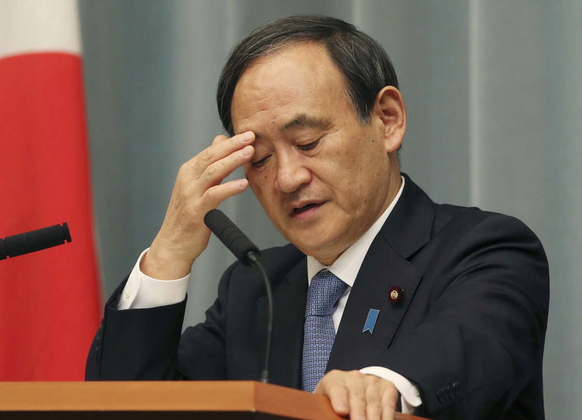 Japan's Government spokesman Chief Cabinet Secretary Yoshihide Suga ponders during a press conference at the prime minister's official residence in Tokyo Friday, Jan. 23, 2015 as militants affiliated with the Islamic State group have posted an online warning that the