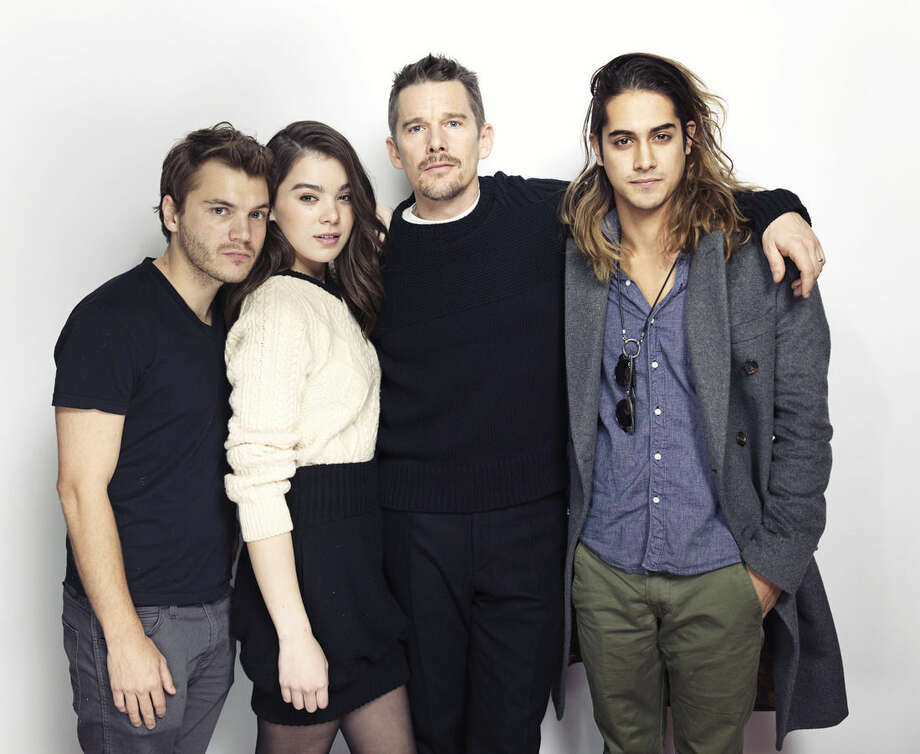"Emile Hirsch, from left, Hailee Steinfeld, Ethan Hawke and Avan Jogia pose for a portrait to promote the film, ""Ten Thousand Saints"", at the Eddie Bauer Adventure House during the Sundance Film Festival on Friday, Jan. 23, 2015, in Park City, Utah. (Photo by Victoria Will/Invision/AP)"