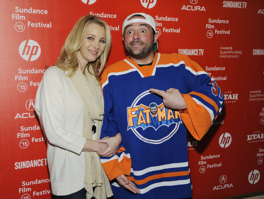 """Lisa Kudrow, left, and Kevin Smith, cast members in the documentary film """"Misery Loves Comedy,"""" pose at the premiere of the film at the Egyptian Theatre during the 2015 Sundance Film Festival on Friday, Jan. 23, 2015, in Park City, Utah. (Photo by Chris Pizzello/Invision/AP)"""