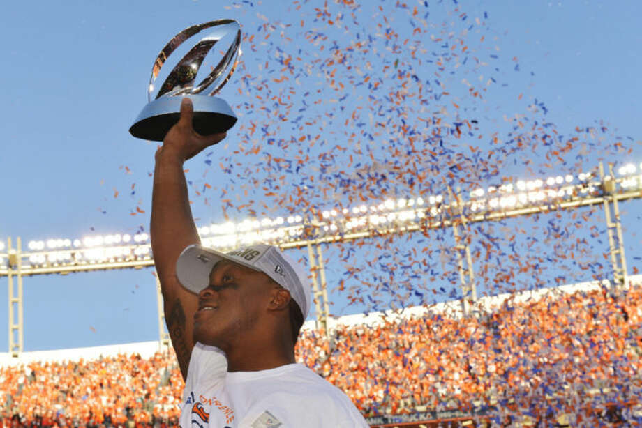Denver Broncos wide receiver Demaryius Thomas holds the trophy after the AFC Championship NFL playoff football game against the New England Patriots in Denver, Sunday, Jan. 19, 2014. The Broncos defeated the Patriots 26-16 to advance to the Super Bowl. (AP Photo/Jack Dempsey)