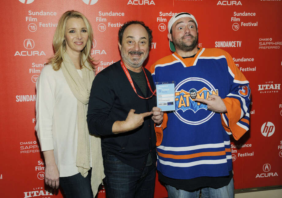 "Kevin Pollak, director and co-writer of the documentary film ""Misery Loves Comedy,"" center, poses with cast members Lisa Kudrow, left, and Kevin Smith at the premiere of the film at the Egyptian Theatre at the 2015 Sundance Film Festival on Friday, Jan. 22, 2015, in Park City, Utah. (Photo by Chris Pizzello/Invision/AP)"