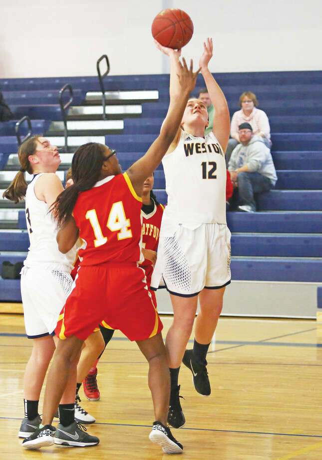 Weston's #12, Grace Toner, takes a shot during a home game against Stratford Sunday afternoon. Hour Photo / Danielle Calloway