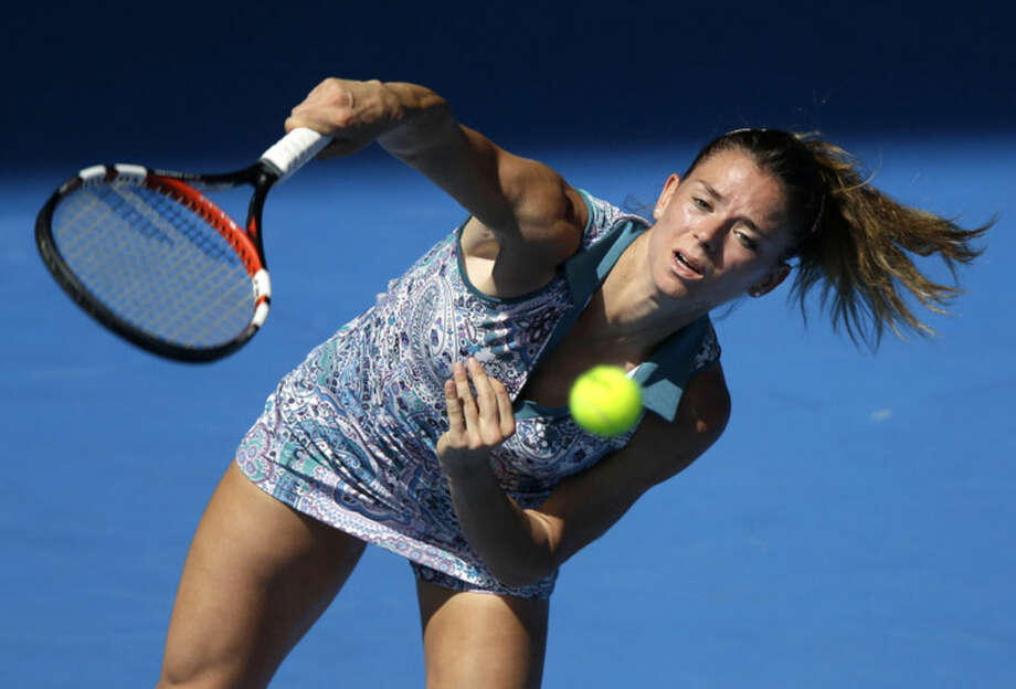 Camila Giorgi of Italy serves to Venus Williams of the U.S. during their third round match at the Australian Open tennis championship in Melbourne, Australia, Saturday, Jan. 24, 2015. (AP Photo/Bernat Armangue)
