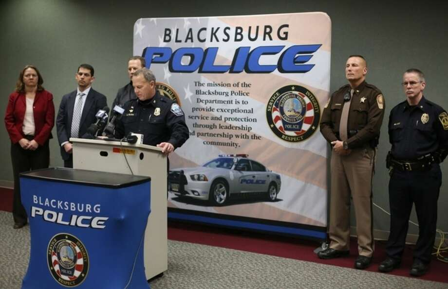 Blacksburg Police Chief Anthony Wilson, center, speaks during a news conference Saturday, Jan. 30, 2016, in Blacksburg Va. Blacksburg Police have arrested and charged a Virginia Tech Student with felony abduction in relation to the disappearance of 13-year-old Nicole Madison Lovell. (Matt Gentry/The Roanoke Times via AP) LOCAL TELEVISION OUT; SALEM TIMES REGISTER OUT; FINCASTLE HERALD OUT; CHRISTIANBURG NEWS MESSENGER OUT; RADFORD NEWS JOURNAL OUT; ROANOKE STAR SENTINEL OUT; MANDATORY CREDIT MBI