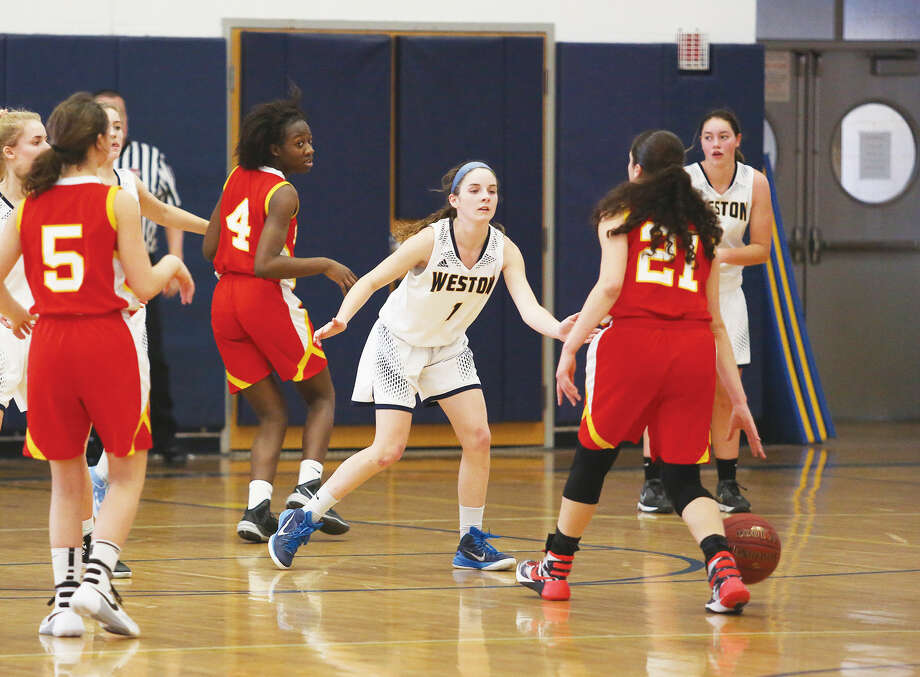 Weston's #1, Katie Orefice, plays defense during a home game against Stratford Sunday afternoon. Hour Photo / Danielle Calloway