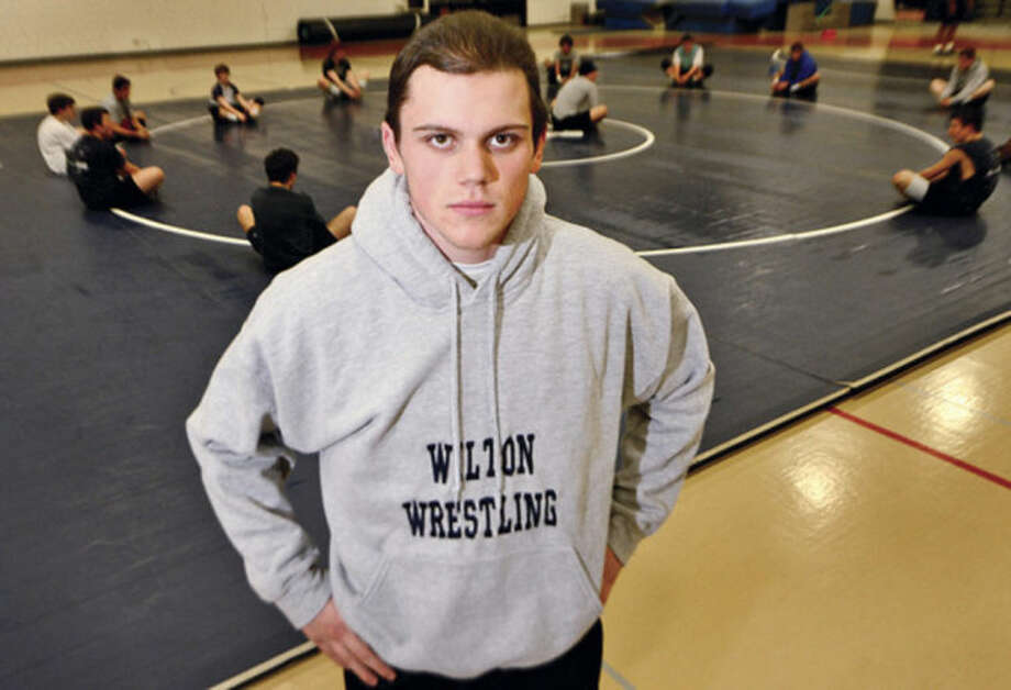 Hour photo / Erik Trautmann Wilton High School wrestler DANNY HOLLAND, this week's subject for On The Record.