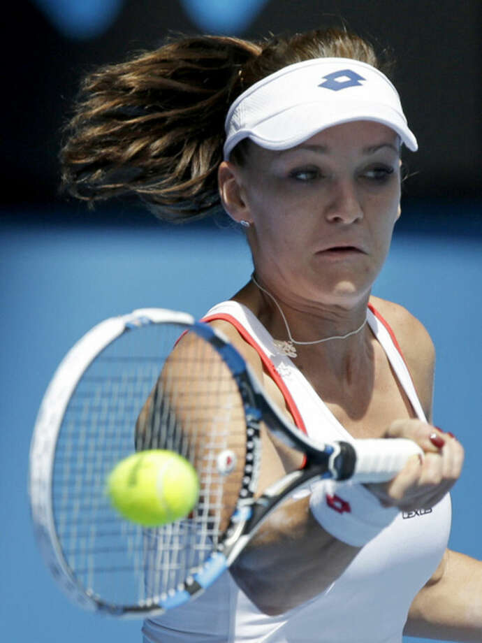Agnieszka Radwanska of Poland hits a forehand return to Varvara Lepchenko of the U.S. during their third round match at the Australian Open tennis championship in Melbourne, Australia, Saturday, Jan. 24, 2015. (AP Photo/Lee Jin-man)