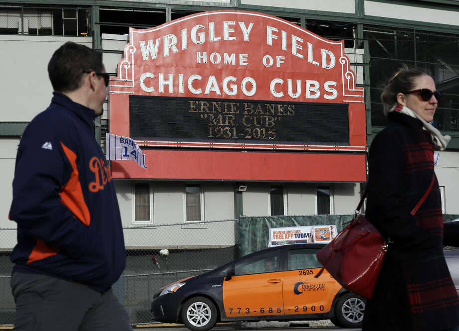 A sign displays at Wrigley Field in honor of Ernie Banks in Chicago, Saturday, Jan. 24, 2014. Chicago Cubs legend Ernie Banks has died at the age of 83. 'Mr. Cub' passed away Friday night at Northwestern Memorial Hospital in Chicago.(AP Photo/Nam Y. Huh)