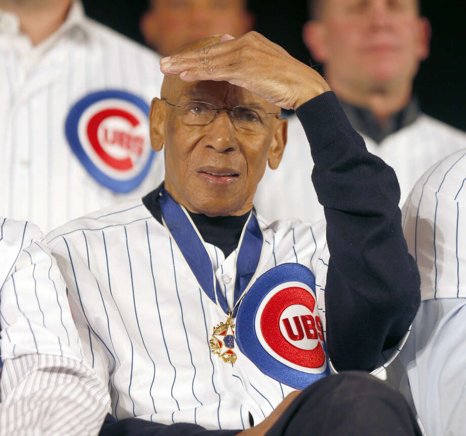 "FILE - Chicago Cubs' Hall of Fame infielder, ""Mr. Cub"" Ernie Banks shields his eyes from a spotlight during the Cubs' annual winter baseball convention in Chicago in this Jan. 17, 2014 file photo. Ernie Banks, the two-time MVP who never lost his boundless enthusiasm for baseball despite years of playing on losing Chicago Cubs teams, died Friday night. He was 83. The Cubs announced Banks' death, but did not provide a cause. (AP Photo/Charles Rex Arbogast, File)"