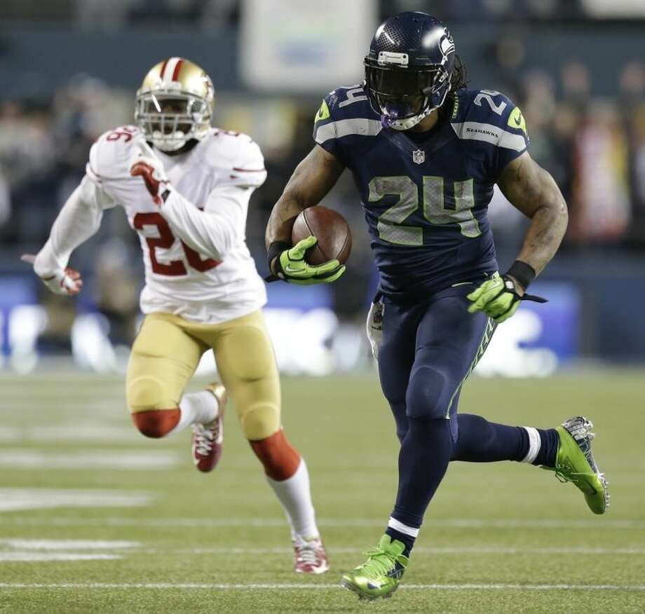 Seattle Seahawks' Marshawn Lynch breaks away for a touchdown run during the second half of the NFL football NFC Championship game against the San Francisco 49ers Sunday, Jan. 19, 2014, in Seattle. (AP Photo/Elaine Thompson)