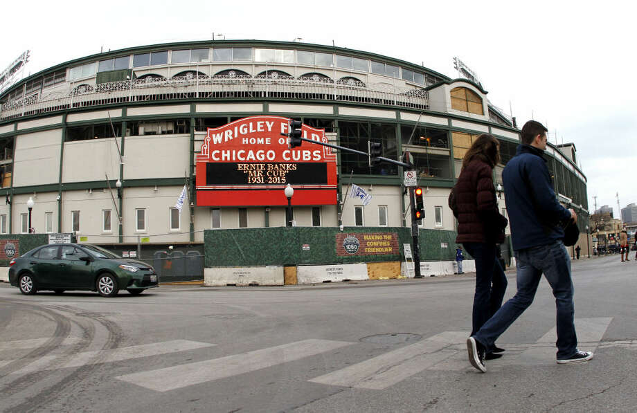 A sign displays at Wrigley Field in honor of Ernie Banks in Chicago, Saturday, Jan. 24, 2014. Chicago Cubs legend Ernie Banks has died at the age of 83. 'Mr. Cub' passed away Friday night at Northwestern Memorial Hospital in Chicago. (AP Photo/Nam Y. Huh)